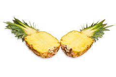 Two halves of pineapple. Royalty Free Stock Photo
