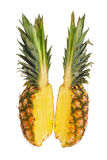 Two halves of pineapple. Royalty Free Stock Image