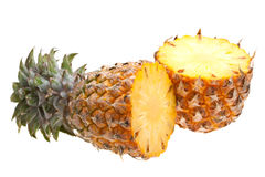 Two halves of pineapple isolated on white Royalty Free Stock Photos