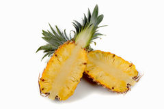 Two halves of pineapple. isolated on white Stock Images