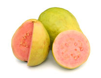 Two halves pink guava. Fresh guava  on a white background Royalty Free Stock Images