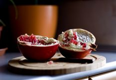 Two halves of pomegranate Royalty Free Stock Photography