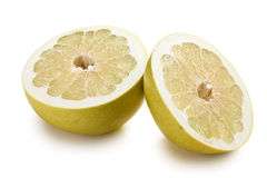 Two halves of pomelo fruit Stock Images