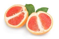 Two halves of ripe grapefruit isolated on white background cutout Stock Photo