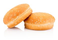 Two hamburger buns with sesame isolated on white background. Two hamburger buns with sesame isolated on a white background royalty free stock images