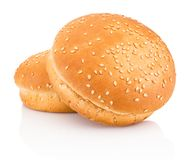 Two hamburger buns with sesame isolated on white background. Two hamburger buns with sesame isolated on a white background royalty free stock photography