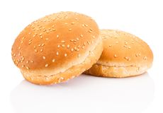 Two hamburger buns with sesame on white background. Two hamburger buns with sesame on a white background royalty free stock images
