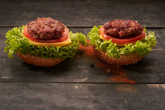 Two hamburger on a wooden table Royalty Free Stock Photo