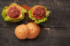 Two hamburger on a wooden table Royalty Free Stock Image