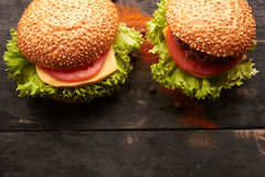 Two hamburger on a wooden table Stock Photo