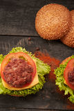 Two hamburger on a wooden table Stock Photography