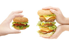Two hamburgers in hands Stock Photo