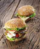 Two hamburgers on old table. Stock Photography