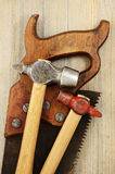Two hammer and old saw Stock Image