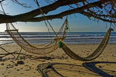 Two hammocks on the beach in the evening sunlight royalty free stock photography