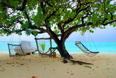 Two hammocks and sea Royalty Free Stock Image