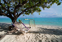 Two hammocks and sea Stock Photo