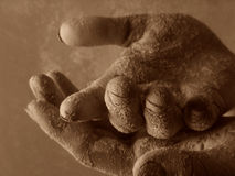 Two hand. S and clay Stock Photography