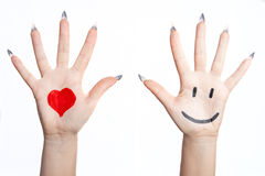 Two hand. Painted heart and smile over the Hand. Isolated on white background Royalty Free Stock Images