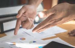 Two hand discussing on business report. Two person hand discussing on business report Royalty Free Stock Image