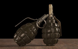 Two hand grenade on black background Stock Photos