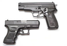 Two hand guns Stock Image