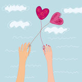 Two hand with hearts balloons Royalty Free Stock Image
