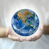 Two hand hold the earth ,including elements furnished by NASA Stock Image
