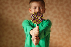Two hand hold lollipop in the indoors Royalty Free Stock Photo