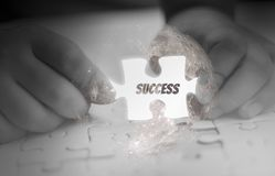 Two Hand holding, jigsaw puzzle piece glowing white, abstract concept business with success and goals and corporate strategy,. Black and white tone,Elements royalty free illustration