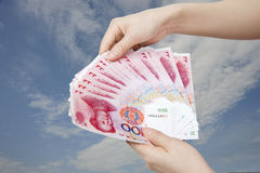 Two hand holding money Stock Images