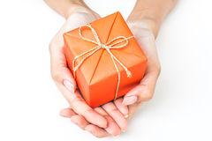 Two Hand Holding Orange Gift Box Royalty Free Stock Photos