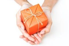 Two Hand Holding Orange Gift Box Royalty Free Stock Photos
