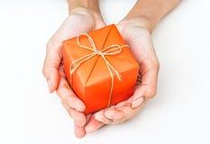 Two Hand Holding Orange Gift Box Stock Photos