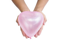 Two hand holding pink balloon Royalty Free Stock Photography