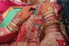 Two hand of indian bride with henna mehndi and pink dress stock photos