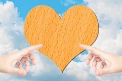 Two hand pressing heart wood Royalty Free Stock Photo
