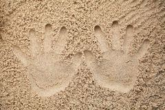 Two hand prints in the sand Royalty Free Stock Images