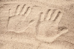 Two hand prints in the sand Royalty Free Stock Image