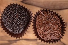 Two hand rolled gourmet chocolate candies royalty free stock image