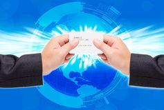 Two hand take a credit card. Two hand use a credit card on the world royalty free stock photography