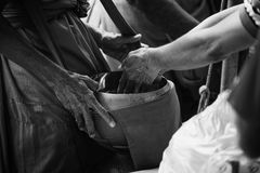 Two hand of thai people Buddhism give alms to monk in alms bowl, black and white high contrast picture style,selective focus Royalty Free Stock Images
