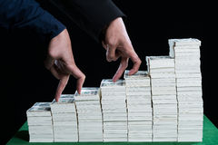 Two hand used fingers are competing in step action walking on pi. Two Hand of male used finger are competing walk step on stack of dollars growing in business Stock Images