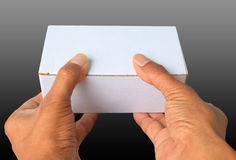Two hand and white box Royalty Free Stock Images