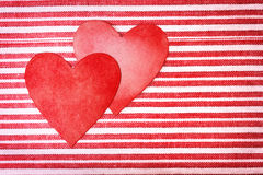 Two handcrafted paper hearts on striped background Royalty Free Stock Photo
