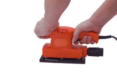 Two handed sander. An isolated over white image of a Orange orbital sander being held by two caucasian male hands royalty free stock images