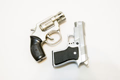 Two handguns. Two different handguns - Revolver-pistol Stock Photos