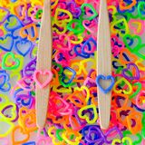 Two handle toothbrushes on colorful mini heart toy stock photos