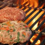 Two Handmade Burgers On The Barbecue Grill. Summer Party Image. Stock Photography
