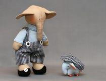 Two Handmade elephants. Elephant and his toy elephant Royalty Free Stock Photo